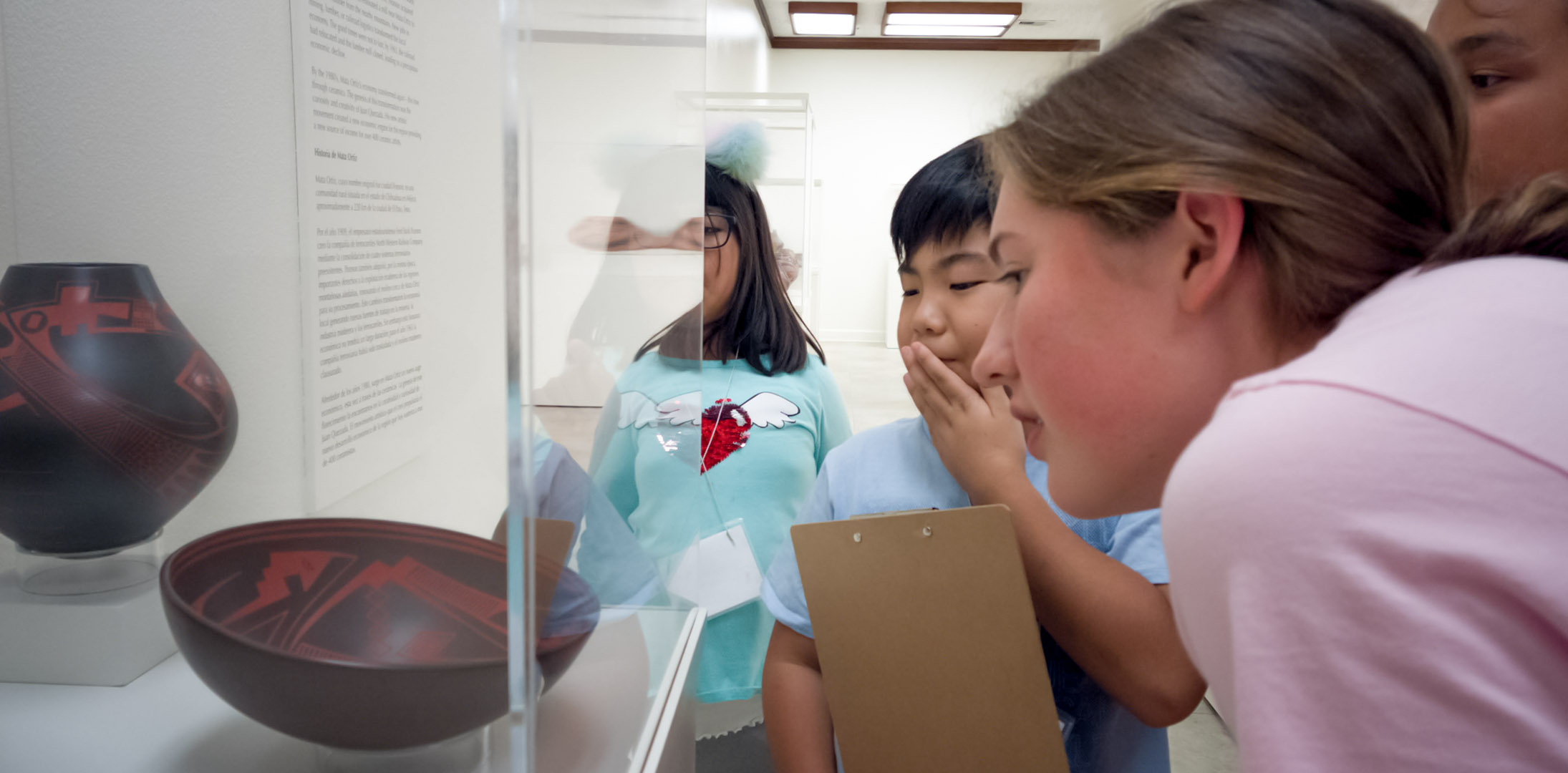 An image of K-12 students touring an Exhibition at AMOCA